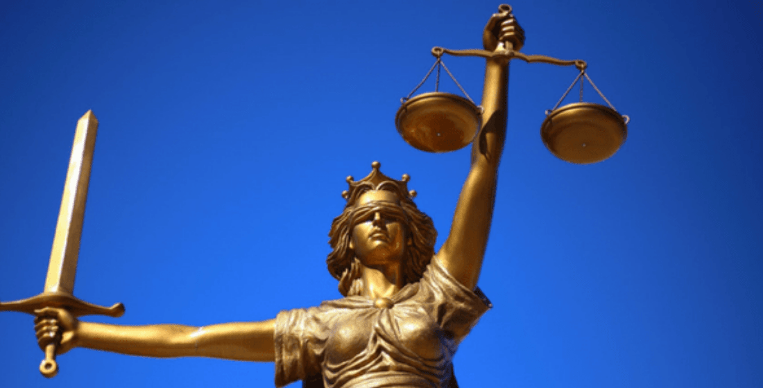 A gold Lady Justice statue