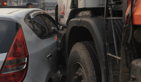Semi truck colliding with car