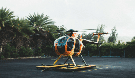 An orange and yellow helicopter