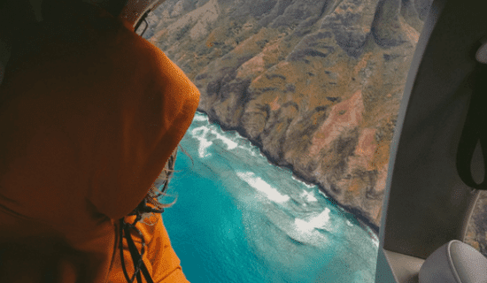 A passenger partaking in one of the safest helicopter tours in hawaii