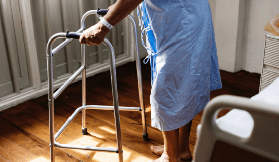 A hospitalized patient with a walker