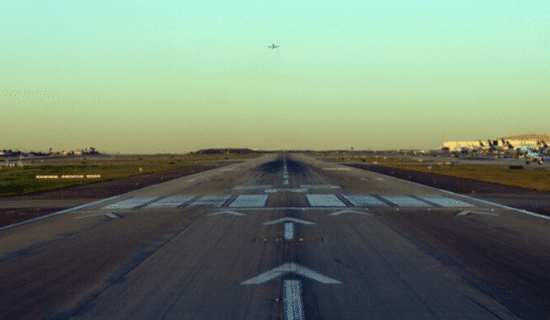 a plane runway at sunset