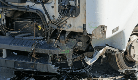 The front of a semi truck that has been damaged