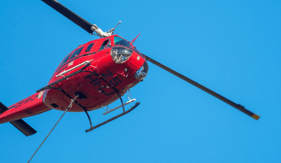 The underside of a red medical helicopter
